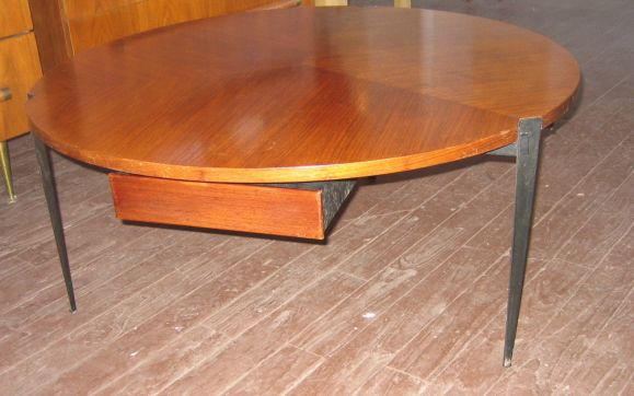 Rare mahogany and steel coffee table. Three legs and three drawers. Beautiful construction throughout.