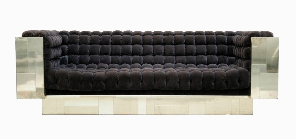 A brass patchwork sofa by Paul Evans for Directional. The deep-tufted velvet seat and interior in the original chocolate velvet upholstery combined with the high shine brass patchwork design are a perfect mix of color and texture. This group is an