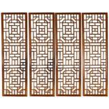 A Set Of Four Window Panels With Lattice Fret Work