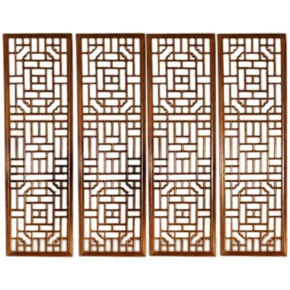 A set of four window panels with lattice fret work at 1stdibs.