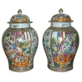 A Pair Of Rose Mandarin Porcelain Jars With Covers