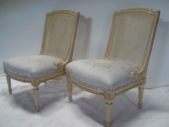A Pair Of Country French Painted Rattan Slipper Chairs At