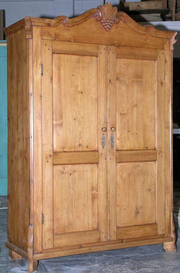 pine armoire with carved grape cluster pediment circa. Black Bedroom Furniture Sets. Home Design Ideas