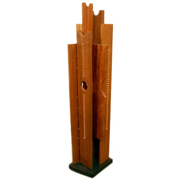 Floor sculpture with exotic woods and colored pegs 1