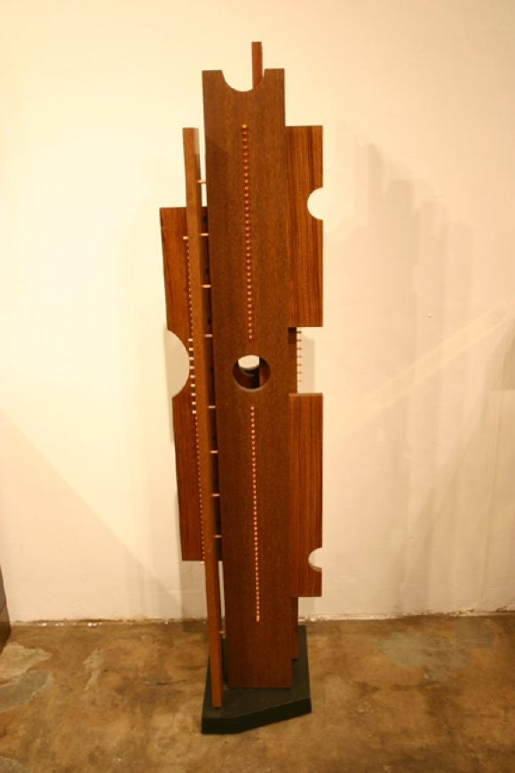 Floor sculpture with exotic woods and colored pegs 3