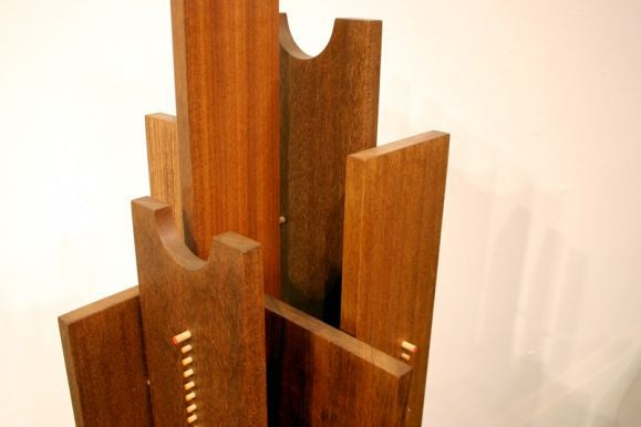 Floor sculpture with exotic woods and colored pegs 5