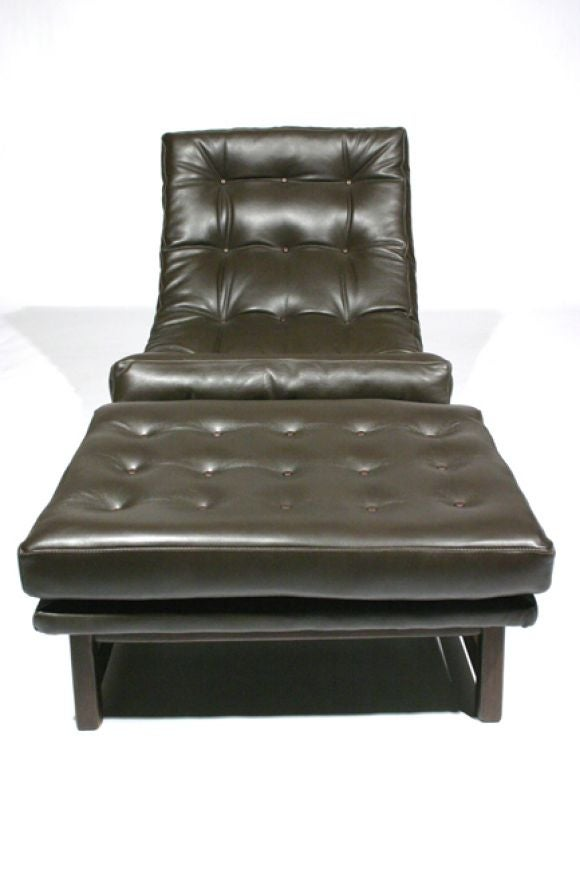 sloped leather lounge chair and ottoman at 1stdibs