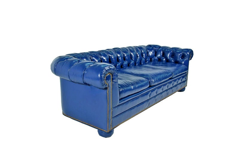 Bright blue leather chesterfield sectional sofa with