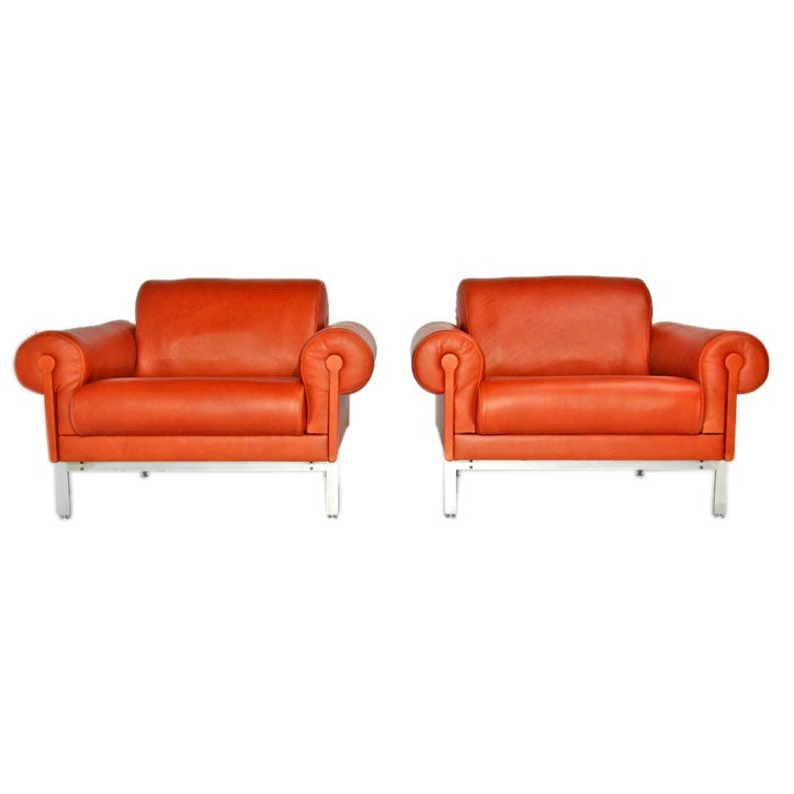 burnt orange leather and steel arm chairs by maison jansen