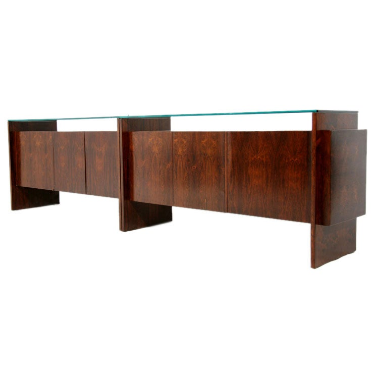 Long rosewood cabinet with glass top at stdibs