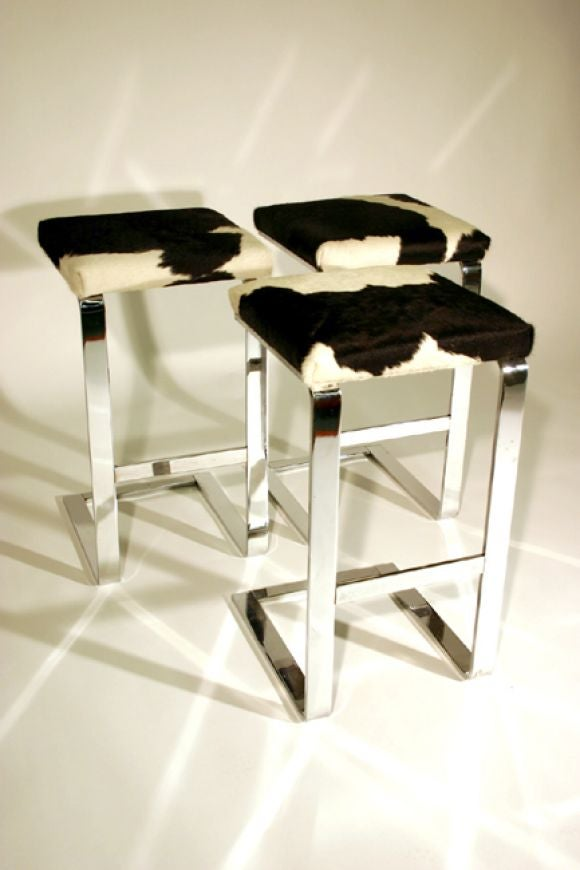 Set Of Three Bar Stools In Chrome Steel With Cowhide Seats
