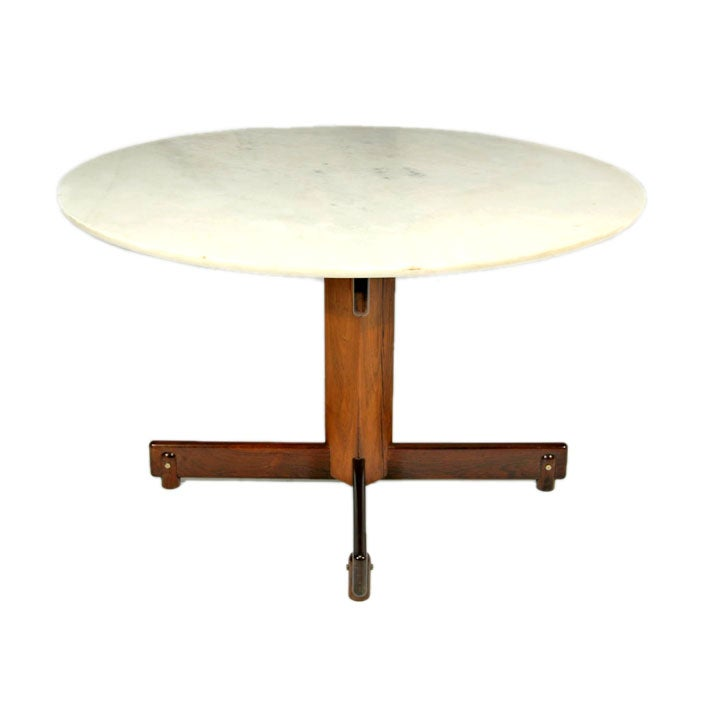 round marble and rosewood dining table by sergio rodrigues