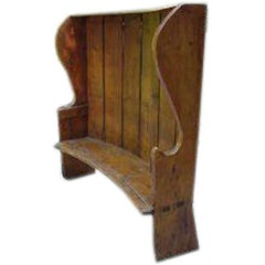A fine curved and panelled back large Pine Settle