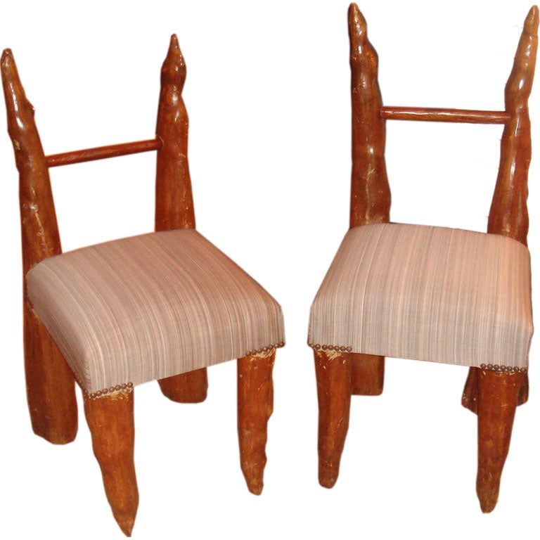 pair of cypress knee chairs from polaroid estate 1