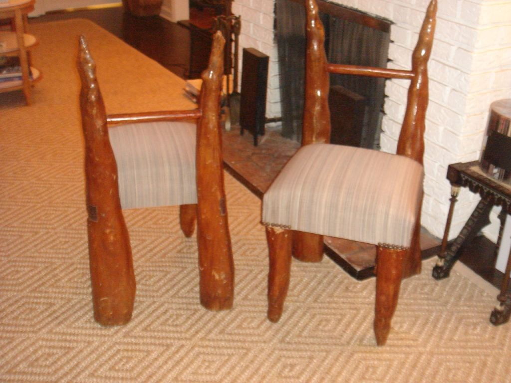 pair of cypress knee chairs from polaroid estate 3