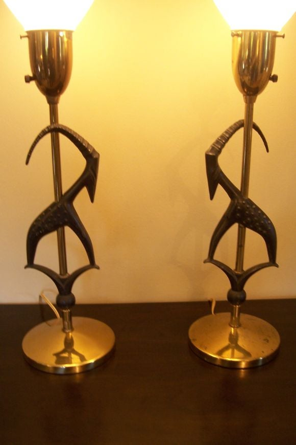 A wonderful pair of antelope lamps by Rembrandt with original restored shades that will make a fun statement to any modern decor.