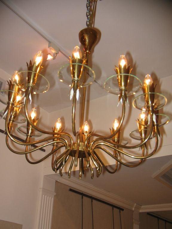 a twelve light brass and crystal chandelier by fontana. Black Bedroom Furniture Sets. Home Design Ideas