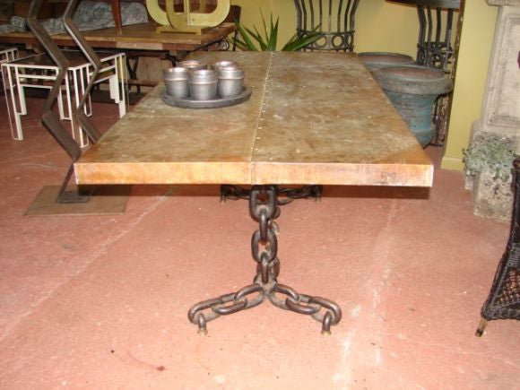 this copper top dining table with iron chain base is no longer