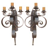 Pair of large iron scroll wall sconces