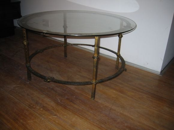 this one round french hand forged gilded wrought iron coffee table is