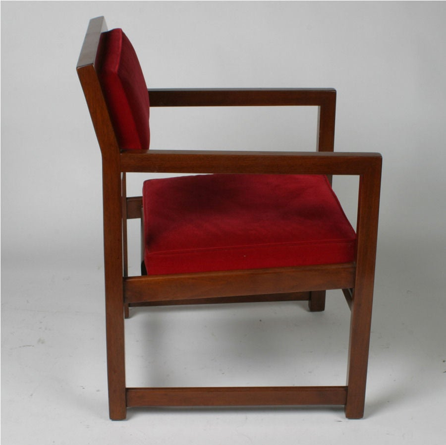 Model number 842, set of eight armchairs in mahogany with red velvet seats.