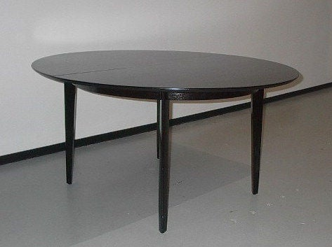 Edward Wormley for Dunbar oval dining table, model # 696. Mahogany slight oval with sculpted legs and inset apron. Two 14