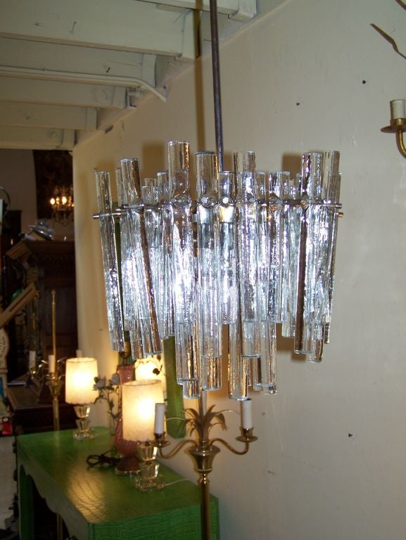 J.T Kalmar chandelier three lights with different size glass tubes.