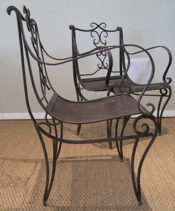 Pair of french wrought iron arm chairs at stdibs