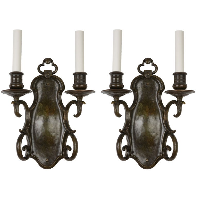 A pair of dark bronze two arm sconces by the E. F. Caldwell Co. at 1stdibs