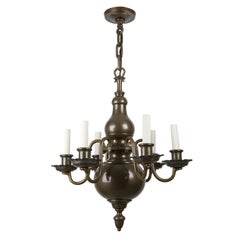 Six-Arm Dark Brass Flemish Style Chandelier by the Edward F. Caldwell Co.