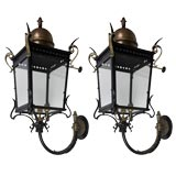 A pair of dark bronze and black cast iron large exterior sconces