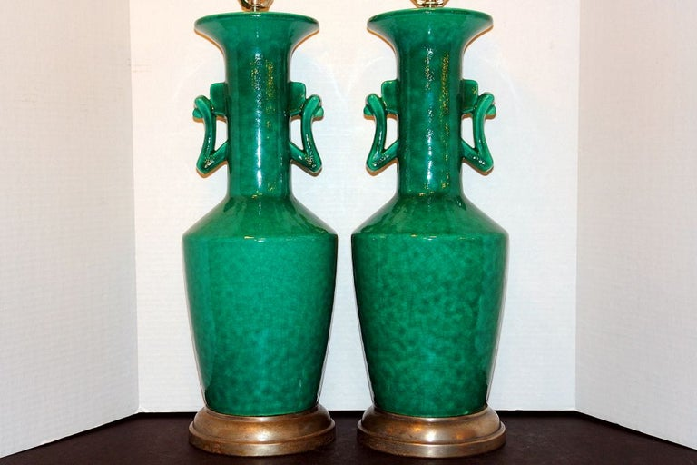 Pair of 1940s French glazed porcelain table lamps with silvered metal base.  Measurements: Height of body: 22