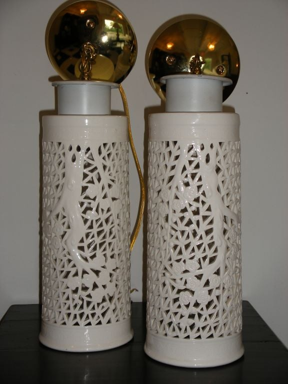 Pierced porcelain - blanc de chine - pair of ceiling fixtures with a ming tree design.  rewired.  Circa 1950s Hollywood Regency style.  I have 2 of these lights.  Price listed is per light.  James Mont style.
