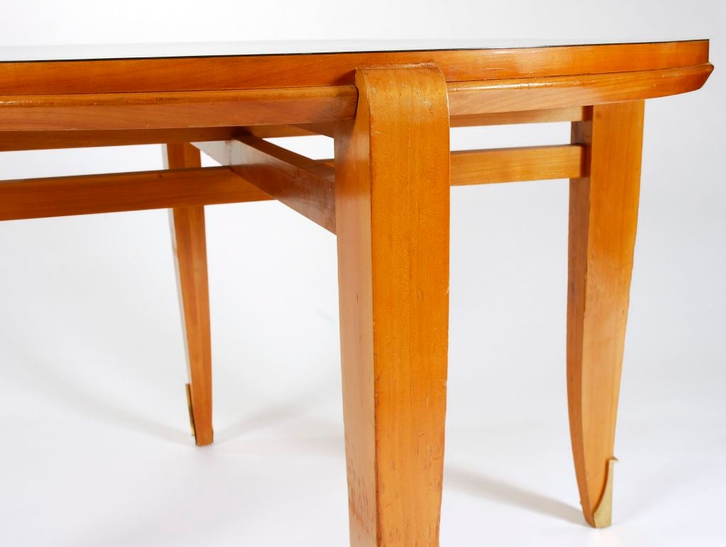black lacquer and cherrywood dining table with brass