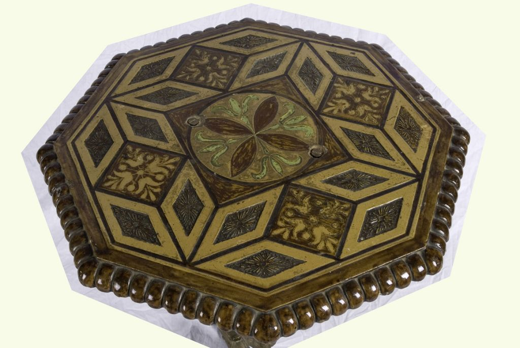 The wonderful geometric pattern of this table is created out of  wood. The three leg central support is gilt-iron and has wonderful scrolled feet. This table is the perfect size next to a sofa or armchair to hold a lamp, accessories and a drink or