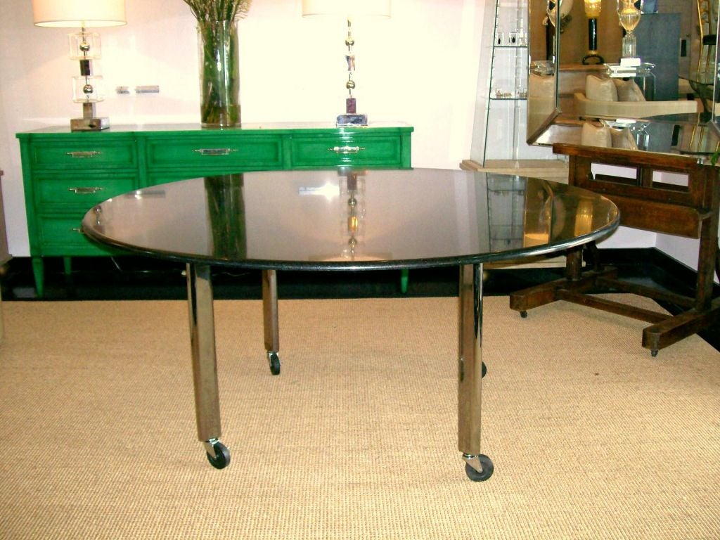 Joe D'urso polished granite table, chrome legs, on casters, for Knoll with metal label and Hand Signed by Joe D'urso.