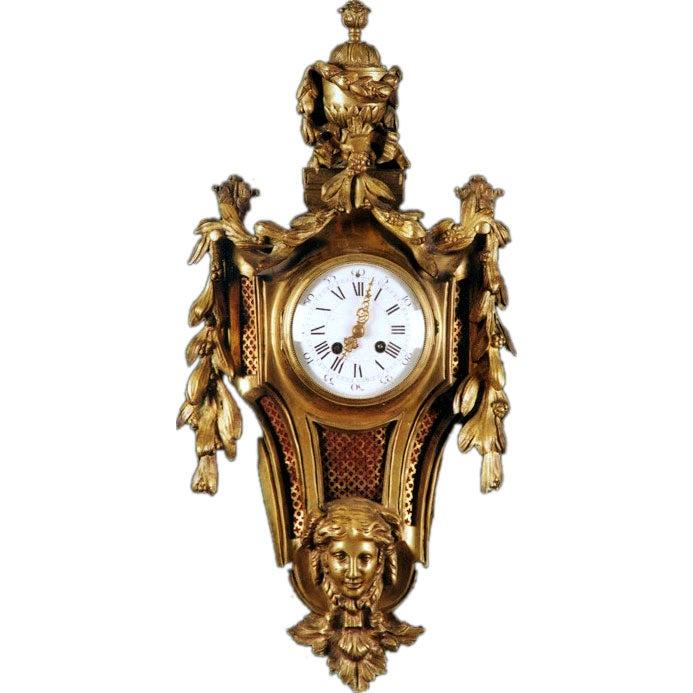 A Louis XVI Style Ormolu Cartel Clock