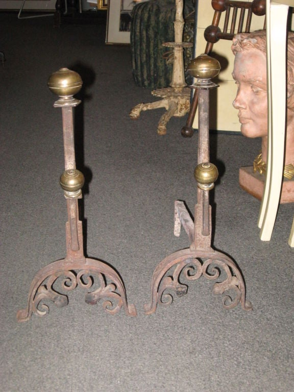 Early brass and iron andirons.