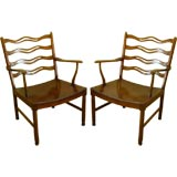 Pair of armchairs designed by Ole Wanscher in teak.