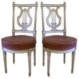 Pair of Louis XVI style painted lyre-back chairs