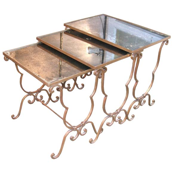 Set of gold patina wrought iron nesting tables at stdibs