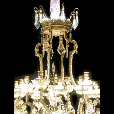 A large Baguès chandelier, gilt iron, crystal and glass, 28 candle holders.