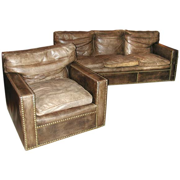 Studded distressed leather sofa and arm chairs at 1stdibs for Studded sofa