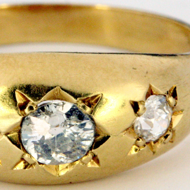 Three-stone antique diamond gypsy ring set in 18 karat gold.  The three diamonds set in star-shaped gold etchings.  Large ring size so can be worn by a man...or sized for a woman!