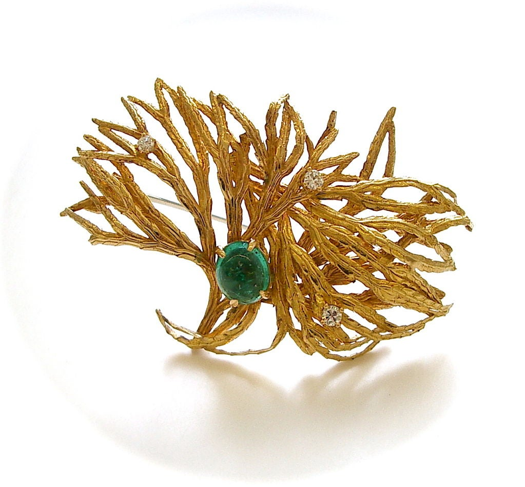 An elegant suite of 18k yellow gold diamond and emerald jewelry by Marianne Ostier. The brooch with textured