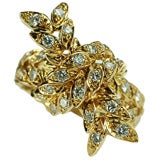 A gold and diamond bow ring, by Tiffany