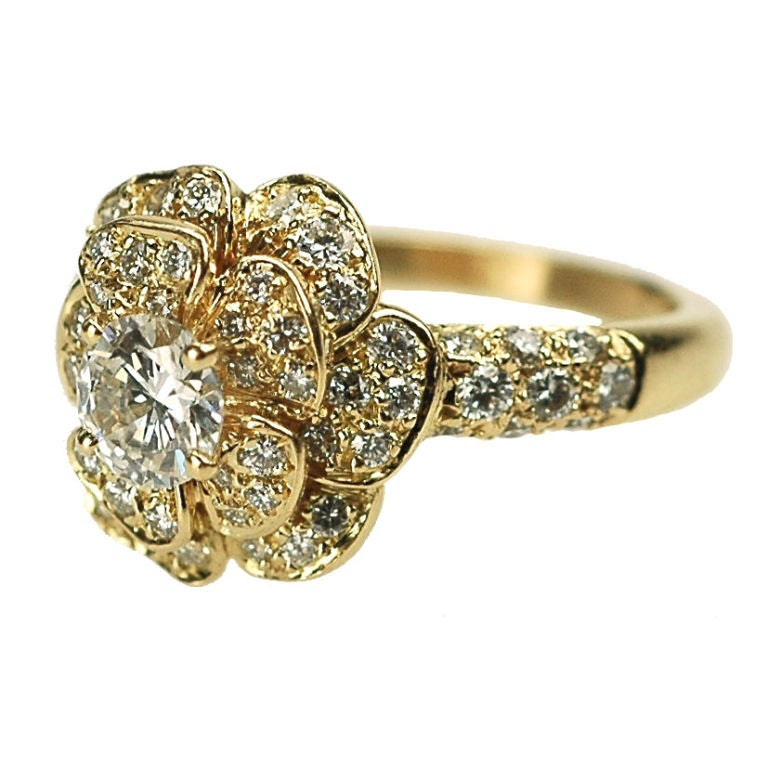 a and gold flower ring by chanel at 1stdibs