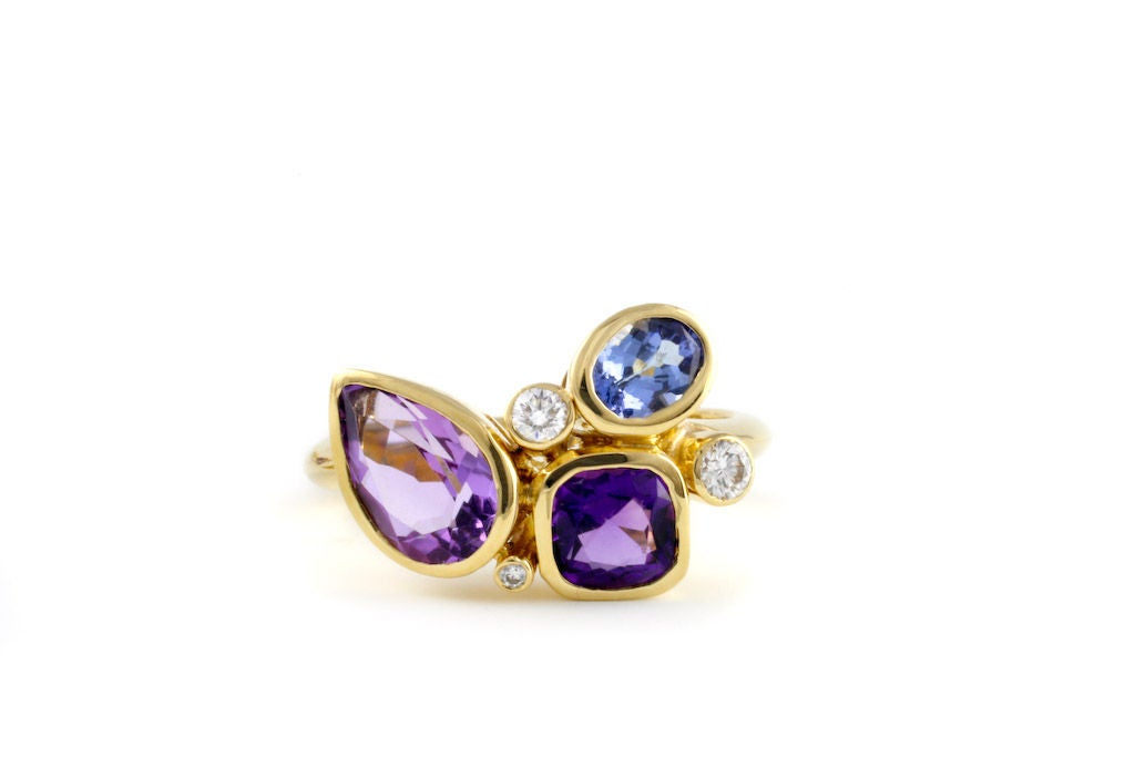 Playful, everyday violet colored ring.  This ring is part of a collection inspired by the whimsical shapes and colors in a kaleidoscope. Designed and made in-house by Julius Cohen New York.