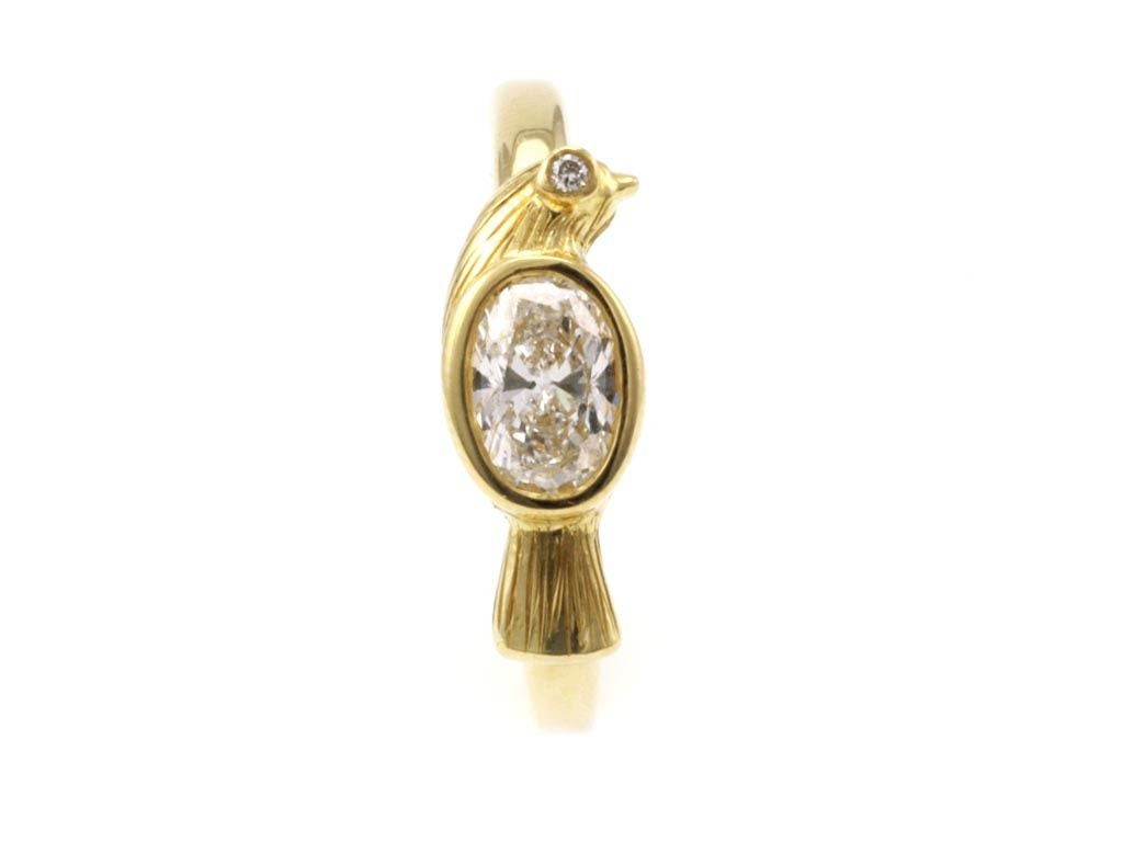 This adorable bird ring is one of our signature pieces.  It is made of 18kt gold with a diamond eye and an oval diamond center stone. It is also available in any birthstone (see additional images, price will vary with stone choice.)   Designed and
