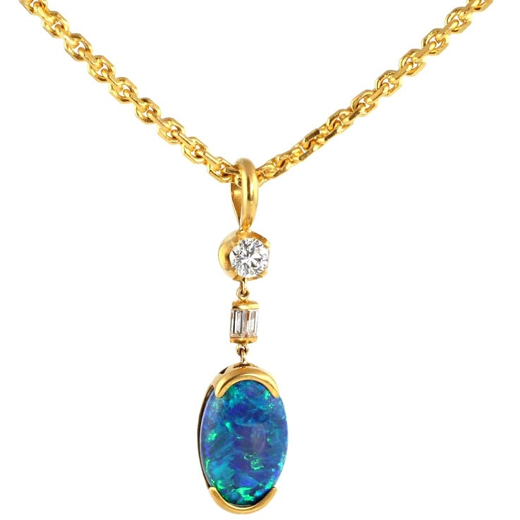 22kt gold and black opal pendant with 22kt gold